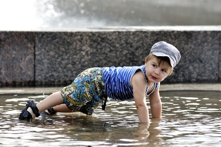 pushup: Little boy doing a push-up in water Stock Photo