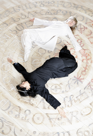 Two young woman in balsck and white dress relaxing with yoga style photo