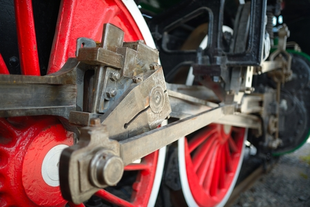 Old locomotive wheels close up photo