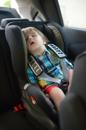 Beautiful baby sleeping in car seat photo