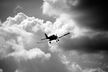 airplane ultralight: Ultralight weight airplane flying in the sky