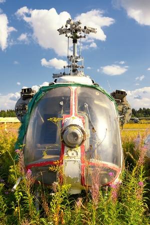 Wreck of chopper in a garden outdoor photo
