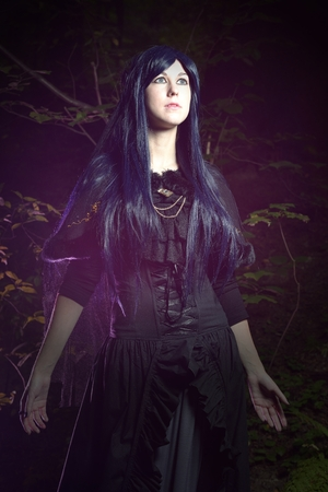 gothic style: The beautiful woman in Gothic style in the forest