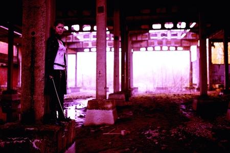 slayer: Woman killer holding Japanese sword on a post-apocalyptical landscape