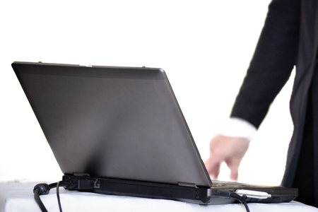 Laptop on table with hand photo