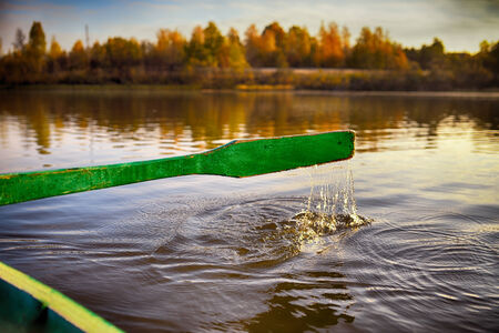 Oar on rowing boats in Russian district floats to the coast