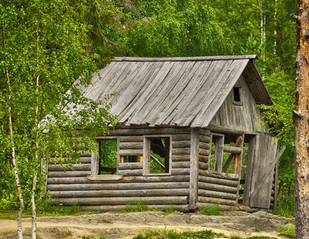 backwoods: Old typical Russian wooden house in the forest