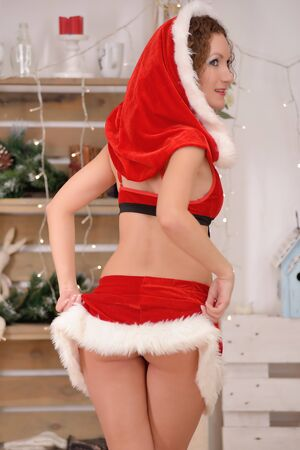 ass christmas: Sexy Santa girl raises a skirt with back view