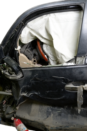 total loss: Revealed safety cushion in the very crumpled car in road accident isolated