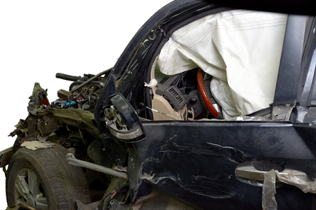 revealed: Revealed safety cushion in the very crumpled car in road accident isolated