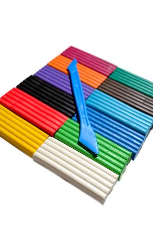 oncept: Multicolor plasticine blocks witch stick background
