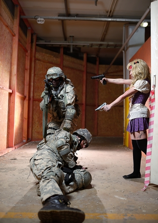 assasin: Japanese style cute schoolgirl directs guns on soldier