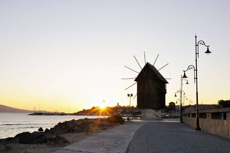 Nesebar mill in the morning sunrise photo
