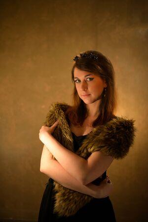 fur coat: Beautiful glamorous woman in fur coat posing at studio.