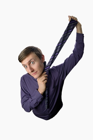Fun fishye a look on young businessman who tries to tie one's tie on white background