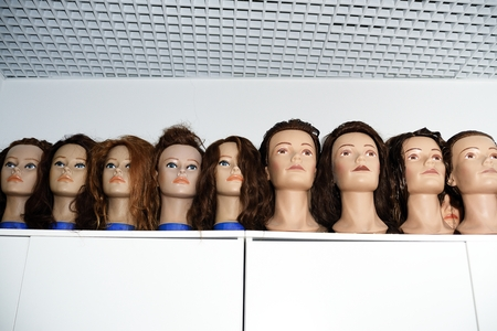 A row of dummies for the hairdresser