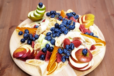 ware: Group fruits on wooden dish ware