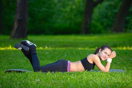 carry out: Sports girl is going to carry out physical exercises Stock Photo