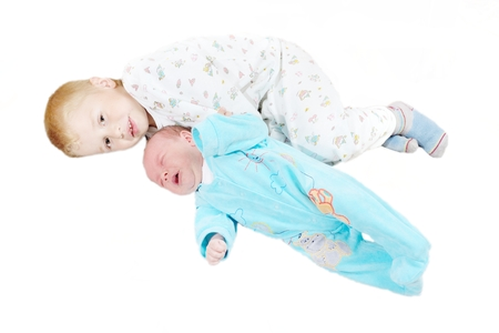 matron: Little brother lies near the newborn child Stock Photo