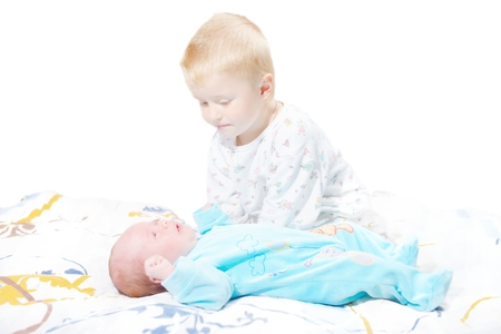 matron: Little brother sits near the newborn child