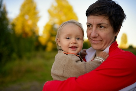 typical: Typical rural woman with little boy outside Stock Photo
