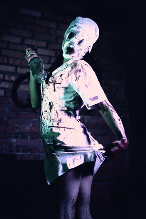 bloodied: Crazy dead Silent Hill nurse with knife in hand