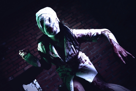 Crazy dead Silent Hill nurse with knife in hand