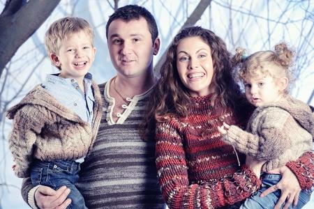 guy portrait: Family portrait standing on studio snow forest background Stock Photo