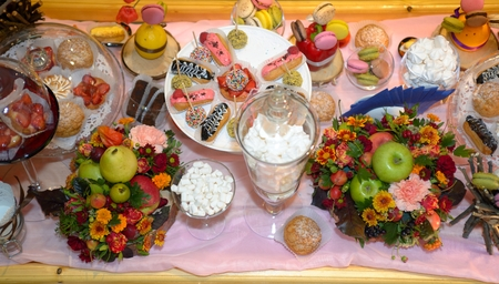 Table served sweet dessert and fruits