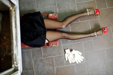 Sexy girl legs in lingerie. Car repairs