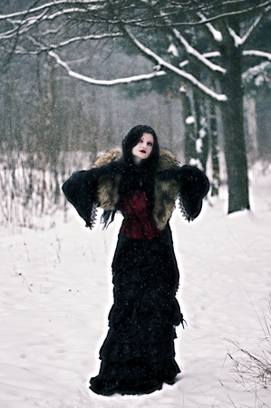 cosplay: Cosplay black witch in winter forest