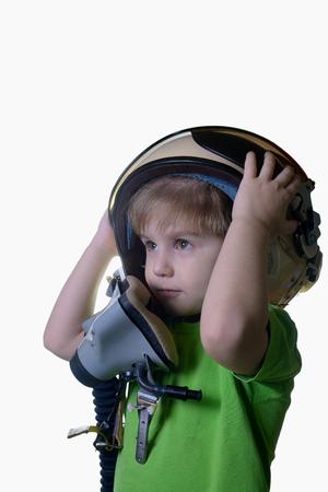 fighter pilot: Funny little child in fighter pilot helmet isolated on white background