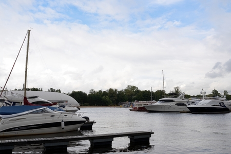 super yacht: Row of luxury yachts mooring in harbour