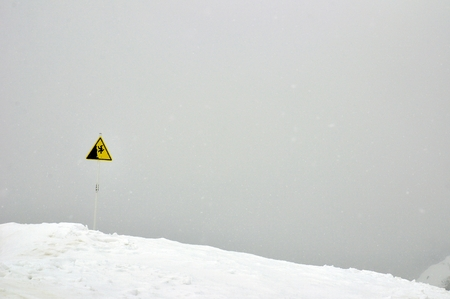 steep cliff sign: Danger steep cliff mountain sign Stock Photo