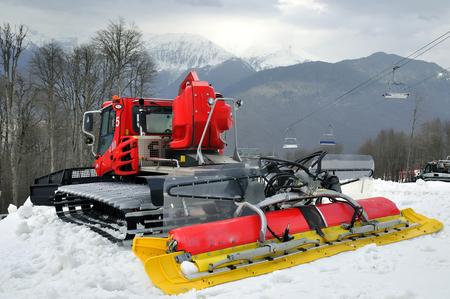 snowcat: Red ratrak in winter scenery