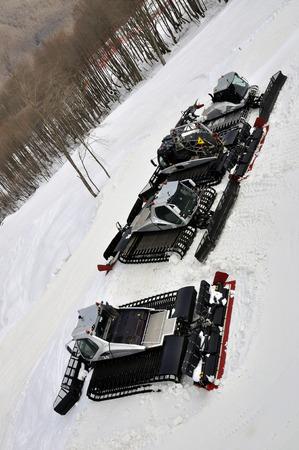 piste: Ratraks, grooming machines, special snow vehicles in ski resort.