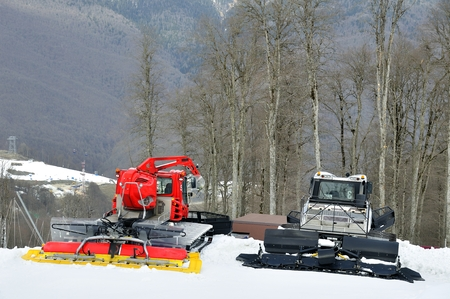snow grooming machine: Two ratrack on skiing slope Stock Photo