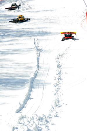 piste: Three ratrak doing track maintenance