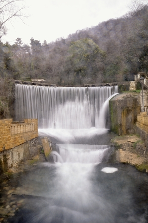 breakaway: Artificial waterfall on river Psyrtsha in Abkhazia New Afon