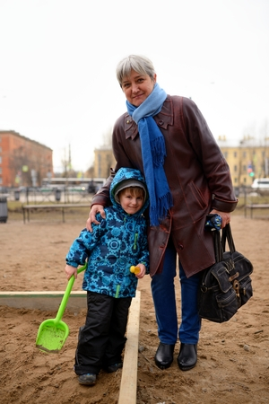 feel affection: Happy grandmother with grandson on playground Stock Photo