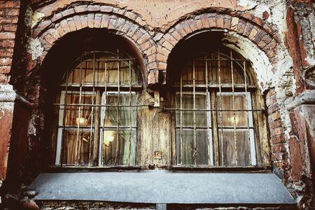 window bars: Old window with rusty bars Stock Photo