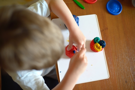 playdoh: Little boy molds from plasticine