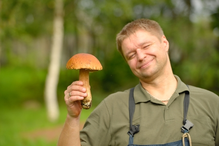 cepe: The happy mushroom picker holds cepe in hand