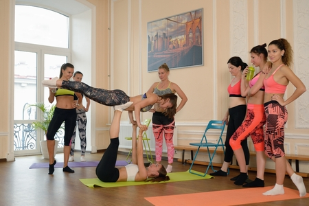 acrobatic: Group of young girl does acrobatic exercise