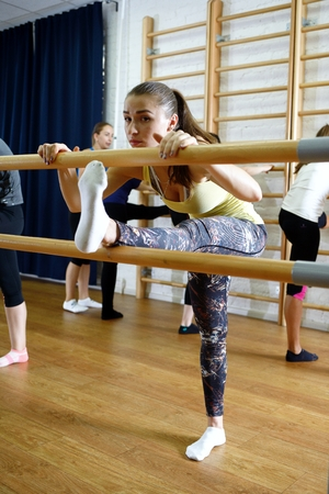 warm things: Group of young sports woman does an extension exercise Stock Photo
