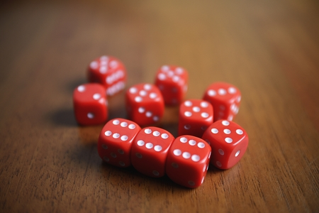 Ten red dice on a table Stock Photo