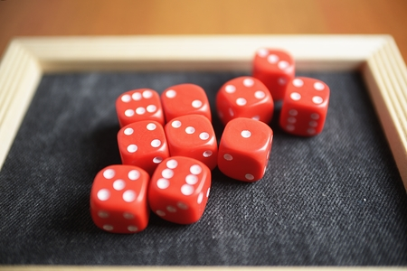 Ten red dice on a black table Stock Photo