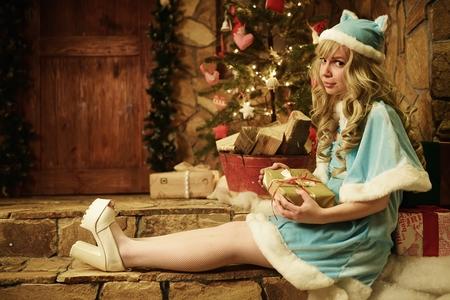 snegurochka: Snow Maiden on doorstep of house decorated in Christmas style