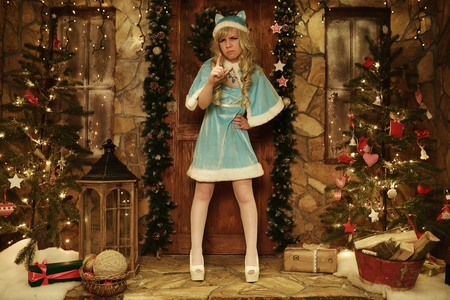 snegurochka: Snow Maiden on doorstep of house decorated in Christmas style
