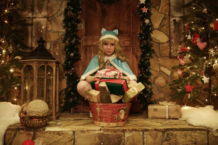 doorstep: Snow Maiden with presents on doorstep of house decorated in Christmas style